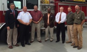 The City Council, Chief Zaydel, Mayor Dally and Representative Bruce Williamson with fire truck