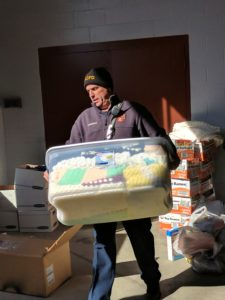Volunteers loading the donations onto the trucks