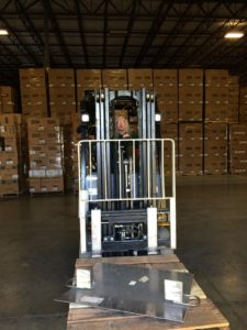 Forklift operator at Dart helping to load the truck